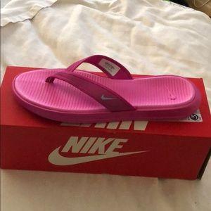 Pink Nike flip flop